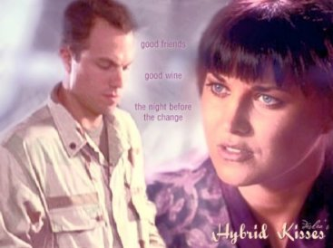 Hybrid Kisses cover art by Deslea.  Adam Baldwin as Knowle Rohrer, Lucy Lawless as Shannon McMahon.